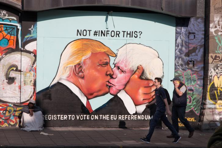 G266MN Satirical street art showing Donald Trump kissing Boris Johnson, to encourage people to vote in the 2016 EU referendum.