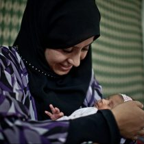 """Limar was born on 3 August the first child of Liqaa and Bassel who currently live in Zaatari camp.   This is what her mother Liqaa had to say:  """"It was such a beautiful day for me and for my husband to see this sweet baby. I was so happy. After giving birth I was tired but after seeing her I forgot about my tiredness.  """"I missed my family so much on that day. I was crying, and until now I miss them so much and think of going back but it's not safe to go back. I wanted to go to give birth in Syria and be next to my family but it was too dangerous.  """"Before giving birth I didn't mind life inside the camp. My husband tried so much to get us out but I refused. But now it's so difficult to raise a baby here. The climate is too hot for her during the day, and in the night it's so cold. Hospitals here are not that good to get medicines and medical services. Adults can get by with the services we have here but for children it's much harder.""""  """"What I wish from the international community is to help the Syrian people to find a political solution, to help us to go back to our country, to our life, to our future.   """"I said earlier that we need peace in Syria for our children. Now that I've given birth to Limar it's even more important for me and for her to have our country back, for her to grow up there with our family. I look forward to going back to Syria as soon as possible."""""""